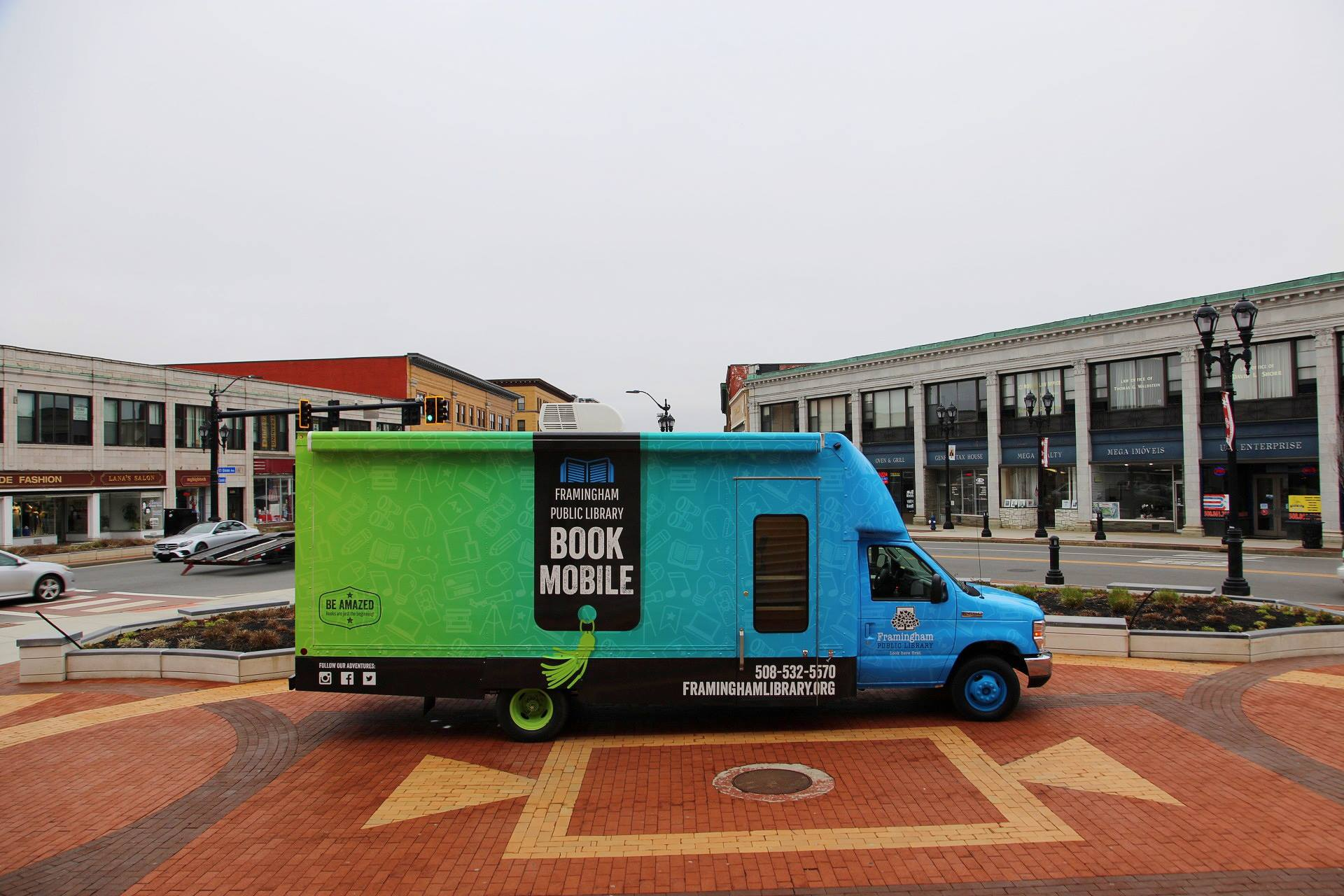 Framingham bookmobile parked on display in plaza in front of City Hall.