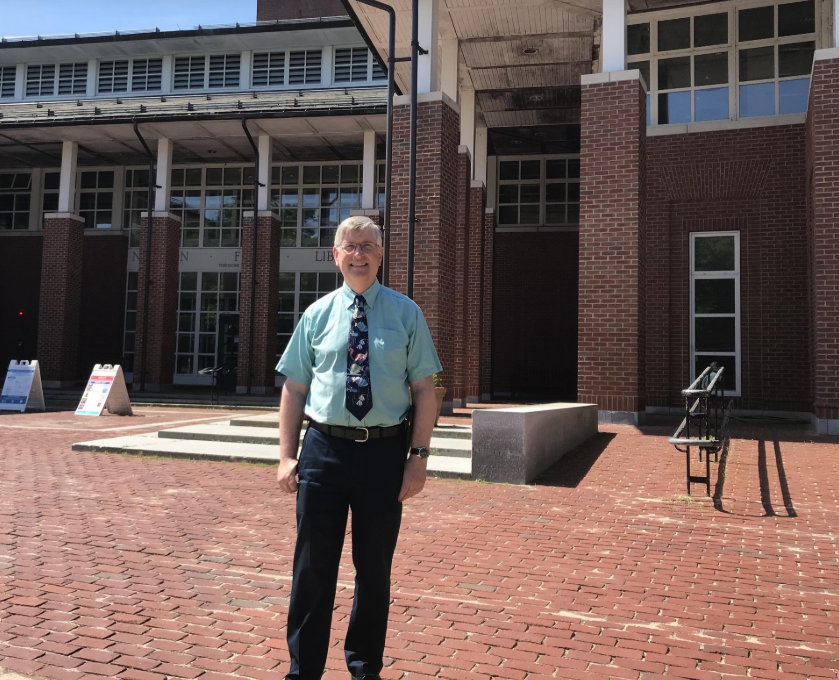 Photo of Phil McNulty standing before Newton Free Library